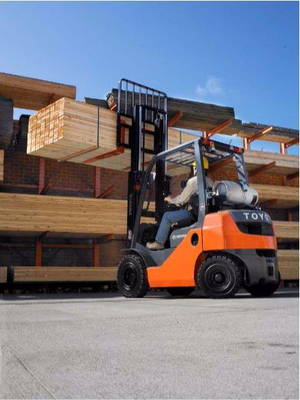 Forklift Moving Lumber