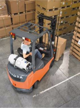 Forklift moving a box